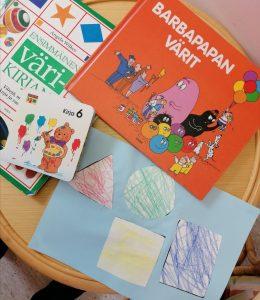 Lasten kirja sekä värikkäät muodot.