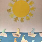 Aurinko ja purjeveneet.