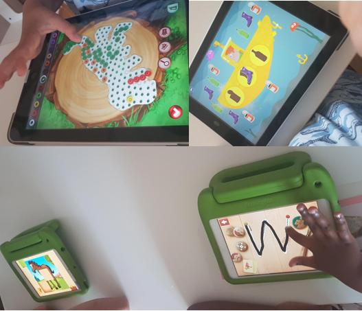 Kuvassa lapset harjoittelevat tablettien käyttöä yhdessä aikuisen kanssa.