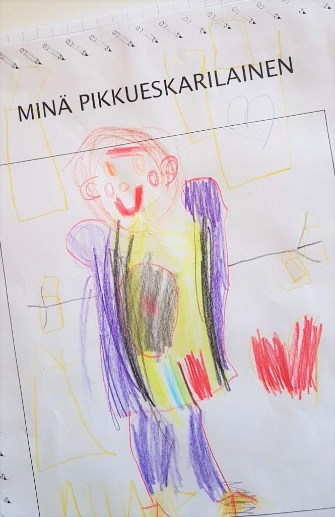 Lapsen piirtämä omakuva.