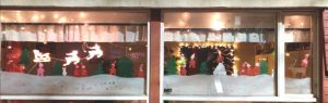 jouluinen ikkunakoristelu, tonttuja ja kuusia, poro ja joulupukki
