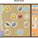 Kuva hiekkarantapelilaudasta missä on simpukoita.